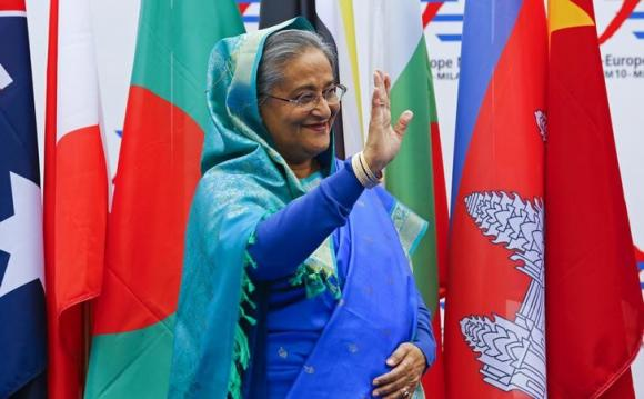 Bangladesh's Prime Minister Sheikh Hasina arrives for the Asia-Europe Meeting (ASEM) in Milan October 16, 2014. CREDIT: REUTERS/STEFANO RELLANDINI