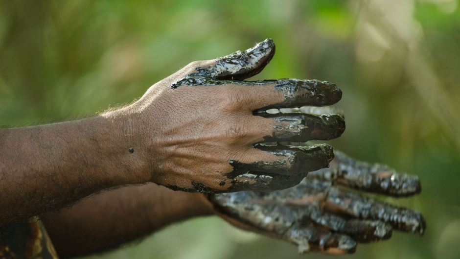 Locals are using their bare hands to collect the oil residue.(Arati Kumar-Rao)