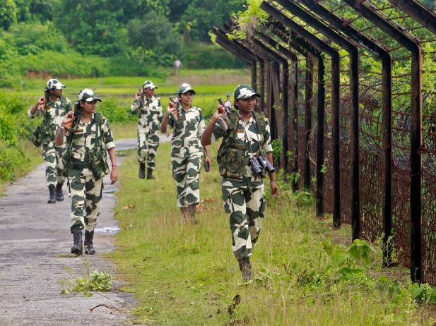 Female personnel of India's Border Security Force (BSF) patrol along the fencing of the India-Bangladesh international border ahead of India's Independence Day celebrations, at Dhanpur village in India's northeastern state of Tripura on August 11, 2014. (Jayanta Dey/Courtesy Reuters)
