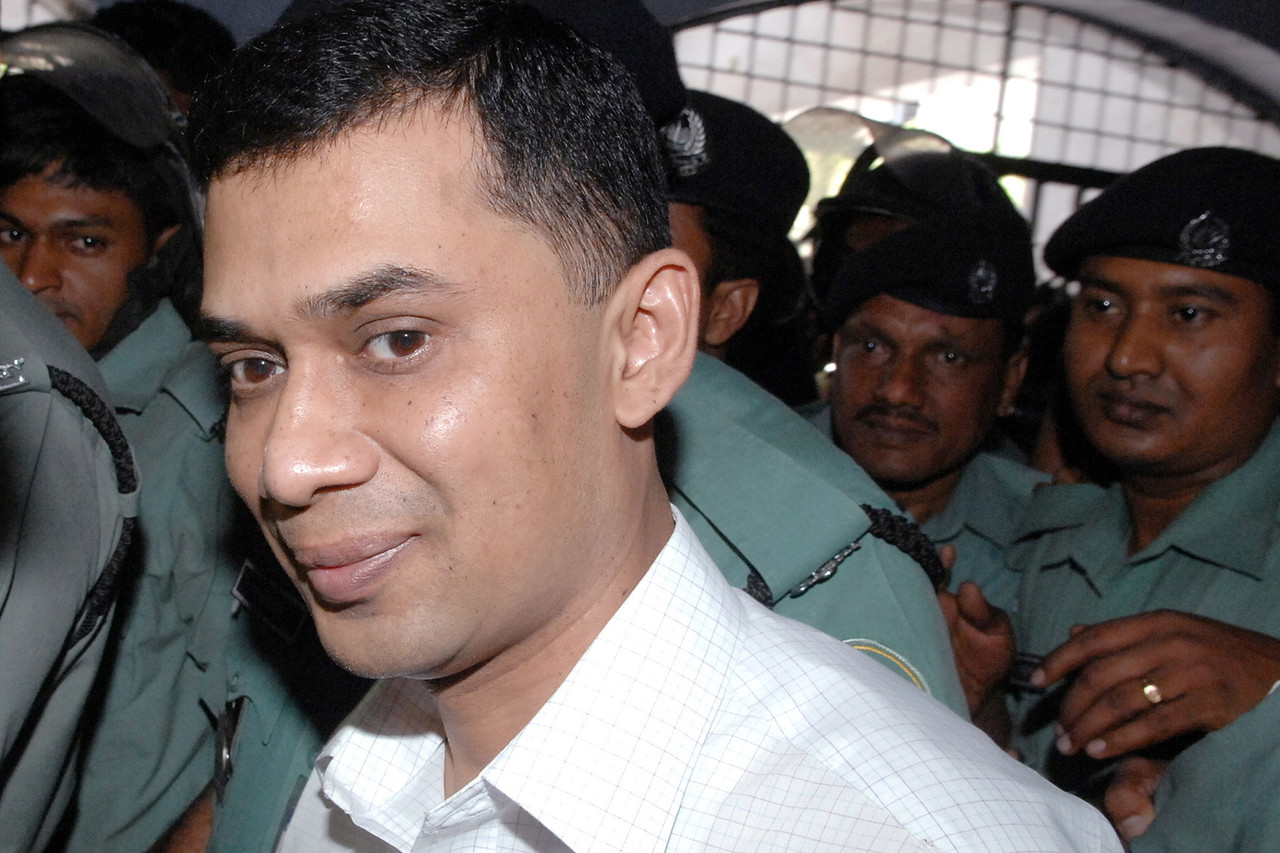 Tarique Rahman, son of former Prime Minister Khaleda Zia and a leader of the Bangladesh Nationalist Party, being escorted to a court in April 2007. SHAMIM AHMED/REUTERS