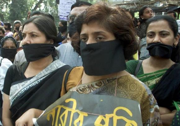 Bangladeshi women wearing masks stage a silent protest against rape in Dhaka on March 6, 2002. CREDIT: REUTERS/RAFIQUR RAHMAN/FILES